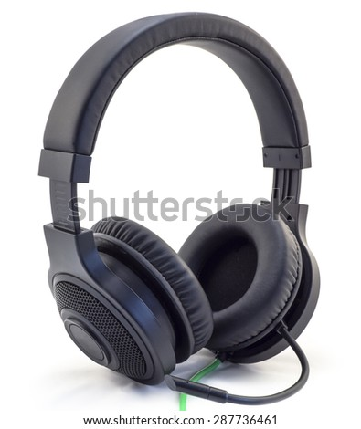 Matt black headphones with a headset with a green wire isolated on white