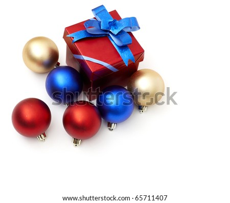 matt christmas balls and a gift in red wrapping on white background, with space for your text