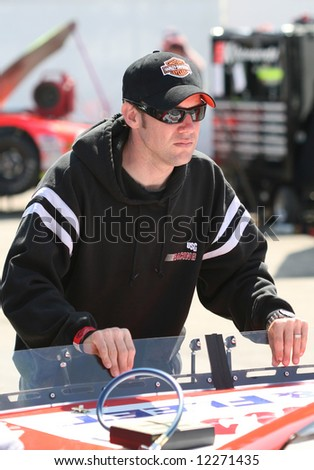 Matt Kenseth pushing son Ross's car at Madison International Speedway opener May 4, 2008 - stock photo