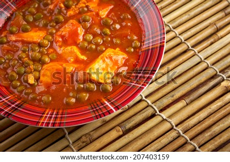 Mattar paneer -  is a vegetarian north Indian dish consisting of peas and farmer's cheese in a tomato based sauce, spiced with garam masala. - stock photo