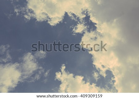 Matte abstract image of blue skies with white clouds
