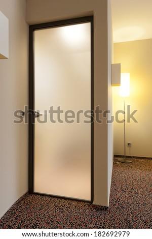 Matte glass hotel toilette door - stock photo