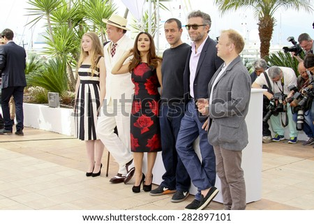 Matteo Garrone, Salma Hayek and Vincent Cassel attend the 'Il Racconto Dei Racconti' ('Tale of Tales') photocall during the 68th annual Cannes Film Festival on May 14, 2015 in Cannes, France. - stock photo