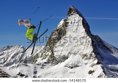 matterhorn and a girl ski jumper - stock photo