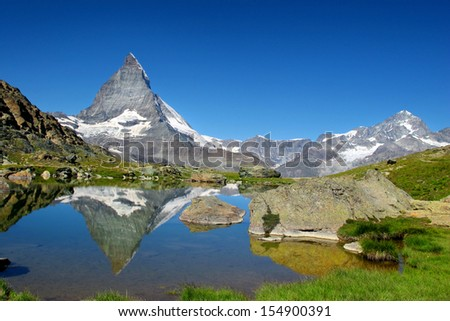 Matterhorn as seen from Riffelsee, Switzerland - stock photo