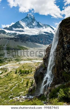 Matterhorn mountain peak with waterfall in summer, Zermatt, Switzerland - stock photo