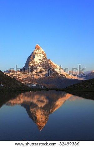 Matterhorn peak and reflection on Riffelsee, Switzerland - stock photo