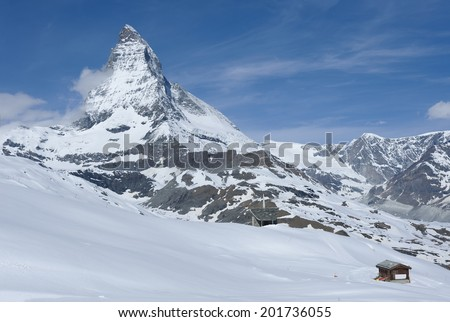 Matterhorn peak with blue sky background, Zermatt, Switzerland  - stock photo