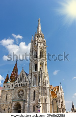 Matthias Church located in Budapest, Hungary, in front of the Fisherman's Bastion - stock photo