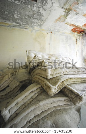 mattresses in an abandoned building - stock photo