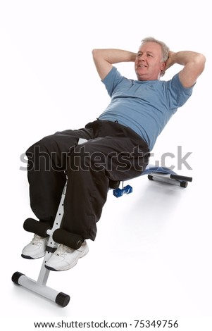 Mature adult exercising his abdomen to stay in shape