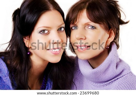 Mature adult mother and daughter portrait on white background