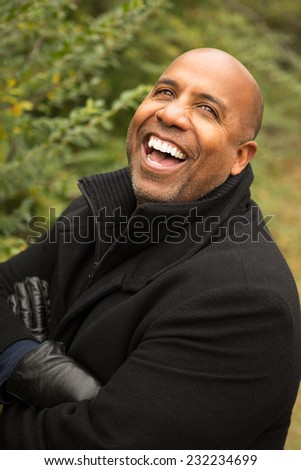 Mature African American man standing outside. - stock photo