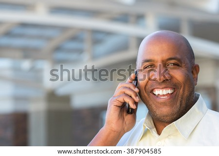 Mature African American man talking on the phone - stock photo