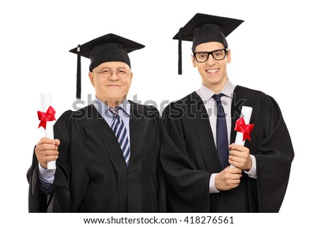 Mature and a young man posing in graduation gowns and holding diplomas isolated on white background
