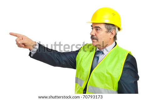 Mature architect man pointing in left part of image to copy space and looking in same direction isolated on white background - stock photo