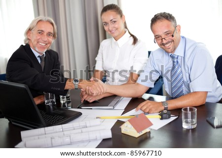Mature architect shaking hands with a clinet - stock photo