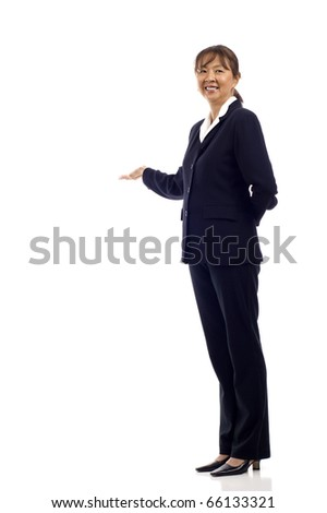Mature Asian business woman presenting something isolated over white background, a lot of copyspace - stock photo