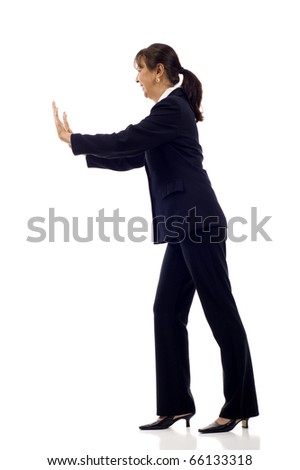 Mature Asian business woman pushing something imaginary isolated over white - stock photo