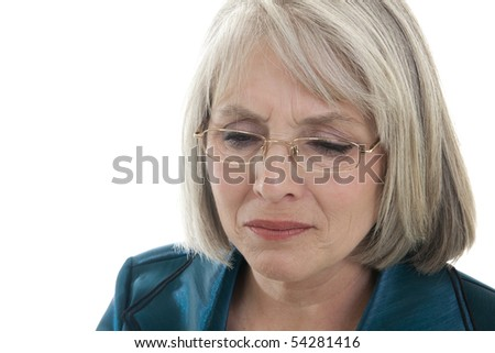 Mature, attractive Caucasian woman grieving - stock photo