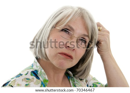 Mature, attractive Caucasian woman making a confused face