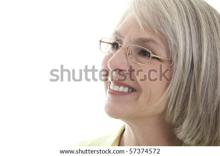 Mature, attractive Caucasian woman smiles at the camera