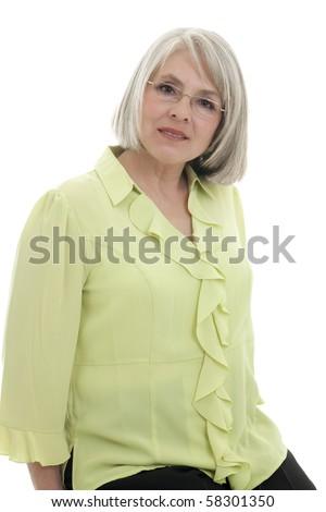 Mature, attractive Caucasian woman smiles at the camera - stock photo