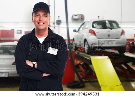 Mature auto mechanic. - stock photo