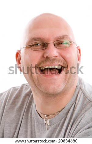 Mature bald man with a very fake laugh - stock photo
