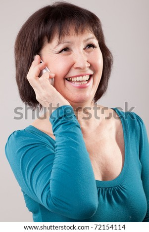 mature beautiful woman using a mobile phone