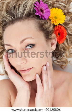 Mature beauty - beautiful woman portrait with flowers in hair - stock photo