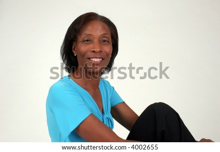 mature, black, african American, woman with a bright smile, looking at the camera.