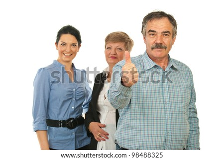 Mature business man giving thumb up in front of his team isolated on white background - stock photo