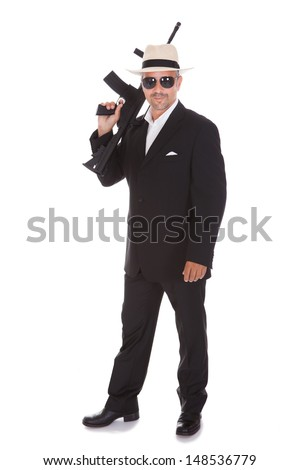Mature Business Man Holding Gun Over White Background - stock photo