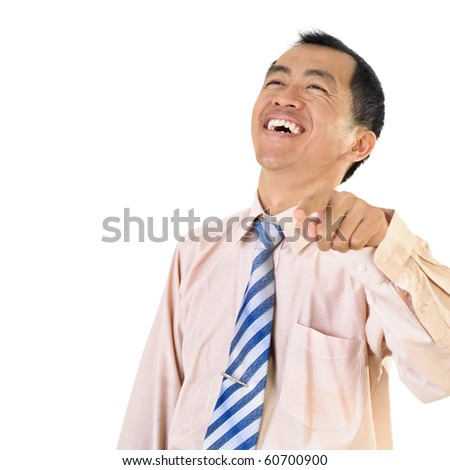 Mature business man laughing and pointing with copyspace on white. - stock photo