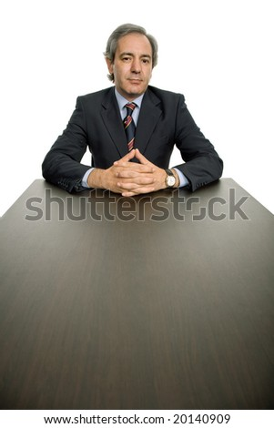 mature business man on a desk, isolated on white - stock photo