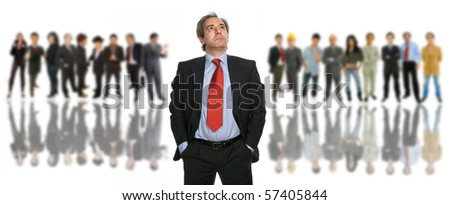 mature business man portrait with some people in the back - stock photo