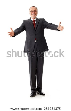 Mature business man says welcome - stock photo