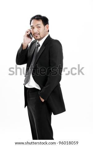 Mature business man talking on the phone over white background