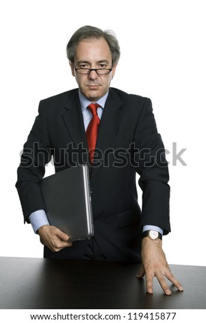 mature business man with his laptop, isolated on white