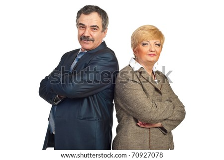 Mature business people standing back to back and looking at camera isolated on white background