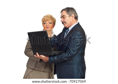 Mature business people using laptop and having conversation together isolated on white background - stock photo