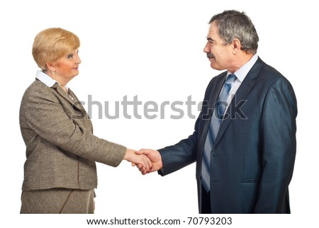 Mature business woman and man making acquintance and shaking hands isolated on white background