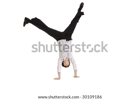 Mature business woman doing a cartwheel - stock photo