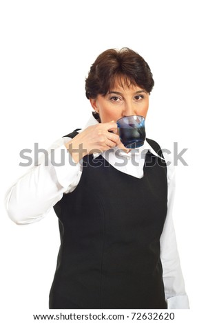 Mature business woman drinking coffee isolated on white background