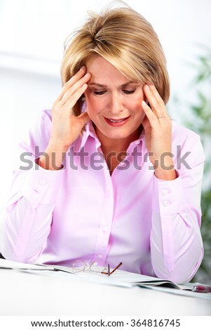 Mature business woman having headache.