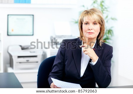 mature business woman in a modern office. - stock photo
