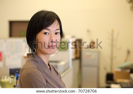 Mature business woman of Asian, closeup portrait in office. - stock photo