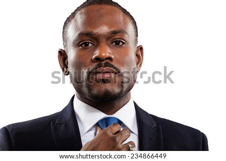 Mature businessman adjusting his tie. Isolated on white - stock photo