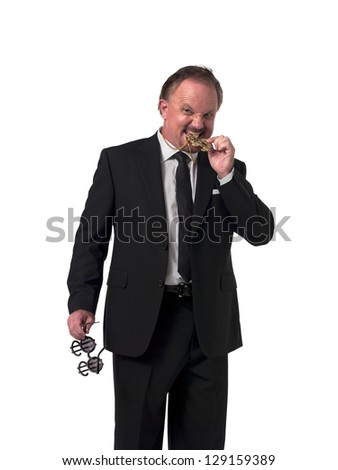 Mature businessman biting his dollar necklace over white background - stock photo